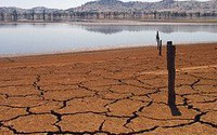 Human and climate impacts on the 21st century hydrological drought